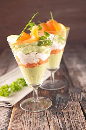 entree: entree, avocado mousse with cream and smoked salmon Stock Photo
