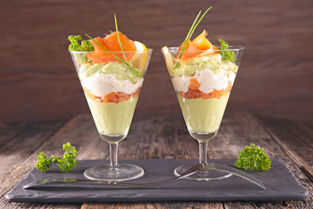entree, avocado mousse with cream and smoked salmon Stockfoto
