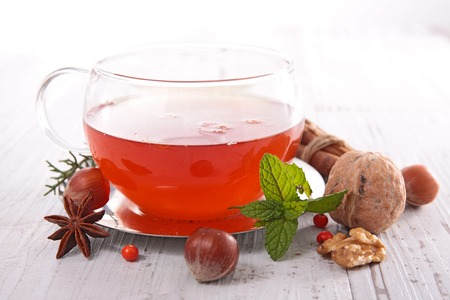 red tea: red tea and nuts Stock Photo