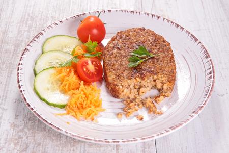 bulgur: vegetarian patties, bulgur galette and salad Stock Photo