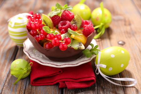 salad decoration: fruit salad in chocolate bowl with easter decoration