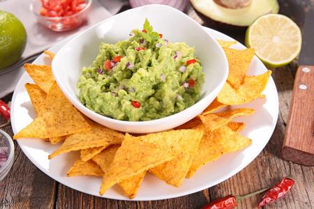 guacamole: guacamole and corn chips Stock Photo