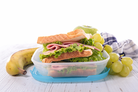 lunchtime: sandwich,lunch box and fruit