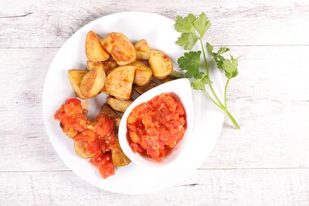 appetizers menu: patatas bravas and tomato sauce