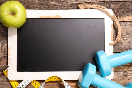 annoucement: blackboard with dumbbell and apple