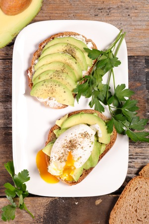 poached: bread with avocado and poached egg Stock Photo