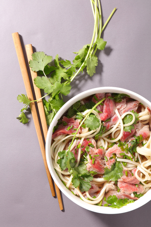 noodles soup: chinese noodles soup with beef and coriander