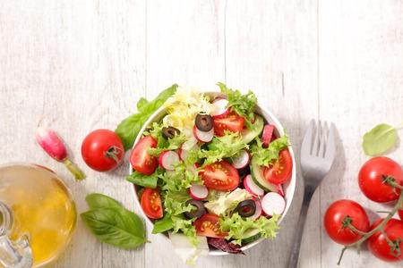 appetizers menu: fresh salad with tomato and radish