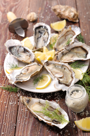 entrees: oyster and lemon Stock Photo