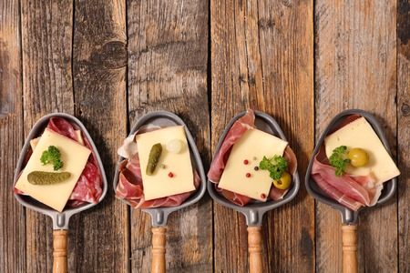 raclette cheese and meats Stockfoto