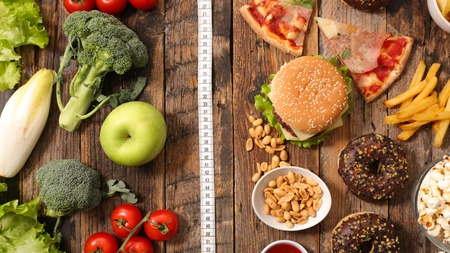 conscience: junk food or health food Stock Photo