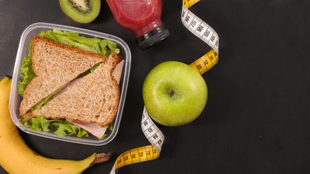 diet food concept, sandwich and fruits