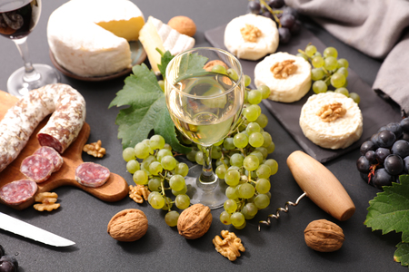 composition with wine,cheese and meats