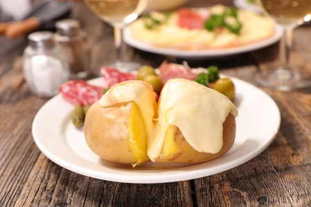 raclette cheese melting on potato