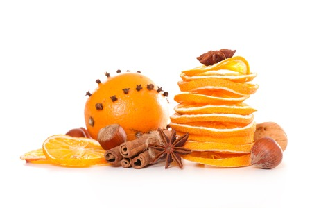 dried orange and spices isolated on white