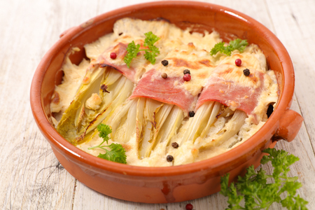 baked chicory with ham and cream Stock Photo