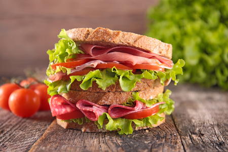 big sandwich on wood background Stockfoto