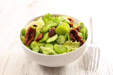 broad bean salad on wood background
