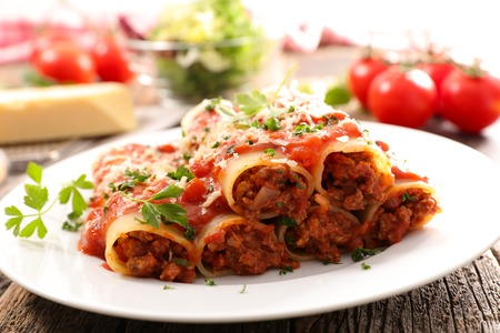 canneloni with beef and tomato sauce