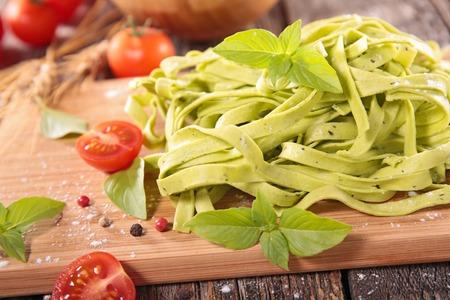 raw tagliatelle and basil Stock Photo