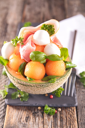 melon, mozzarella and prosciutto salad Фото со стока