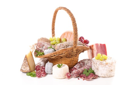 wicker basket with cheese, salami and grape
