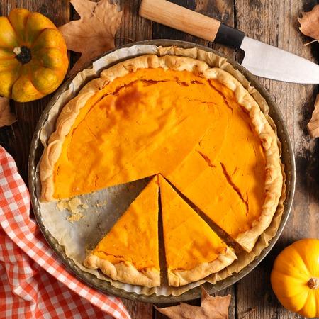 pumpkin pie on wood background