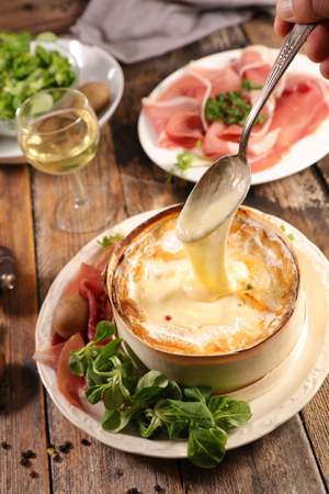 mont d'or, cheese melted with potato and ham