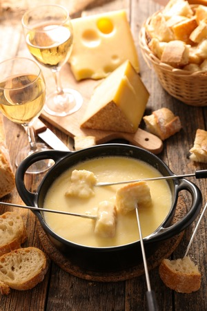 cheese fondue with wine and bread Stock Photo