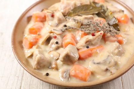 veal stew with cream and vegetables Stock Photo