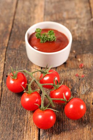 tomato sauce on wood background Stock Photo