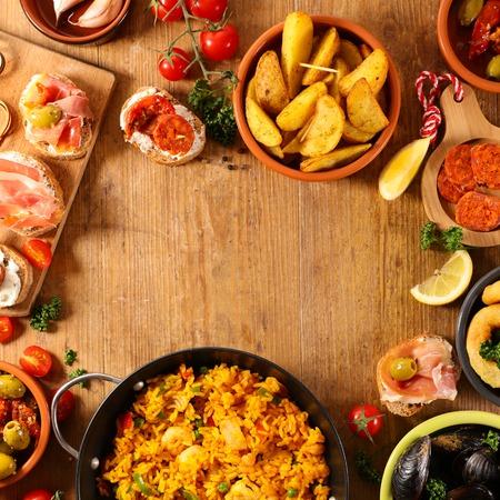 differents sort of spanish food. paella, tapas, potato,mussel 免版税图像