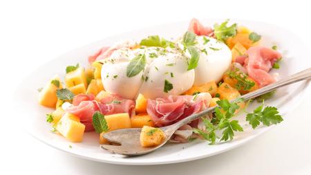 melon slices with prosciutto ham and mozzarella Stok Fotoğraf
