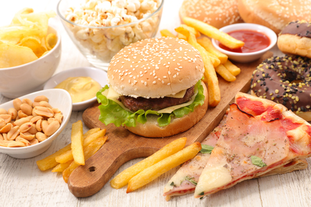american food with hamburger, french fries, pizza Stock Photo
