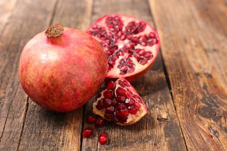 fresh pomegranate with wood background