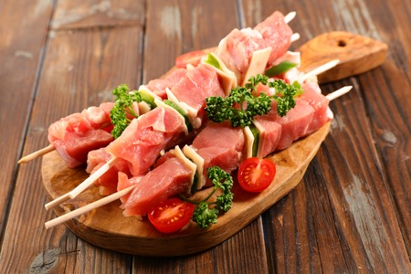 raw meat, skewer on wooden board for barbecue