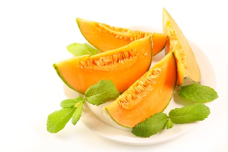 melon slices with mint leaf