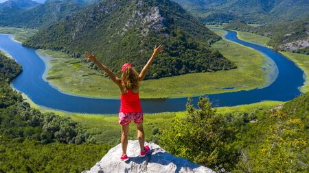 panormic view of landscape of lake skadar in Montenegro, woman happy or holiday concept Zdjęcie Seryjne