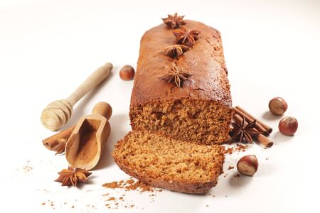 gingerbread cake with spices and ingredients on white background Stockfoto