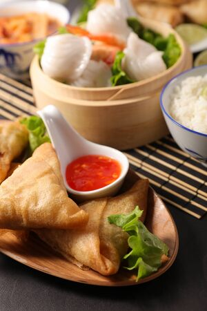 asian food with samosa, dumpling, spring roll and sauce Stockfoto