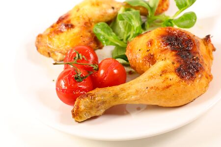 grilled chicken leg and tomato isolated on white background Stockfoto