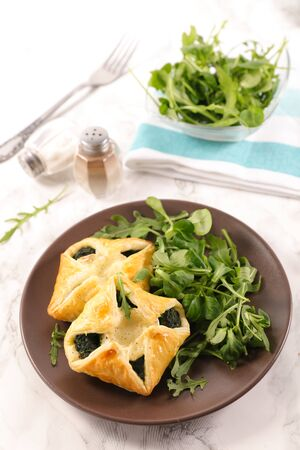 pastry filling with spinach and salad