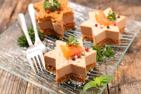 festive canape with foie gras and salmon Stockfoto