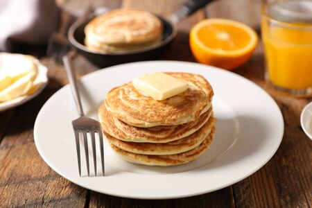 pancake with butter and orange juice