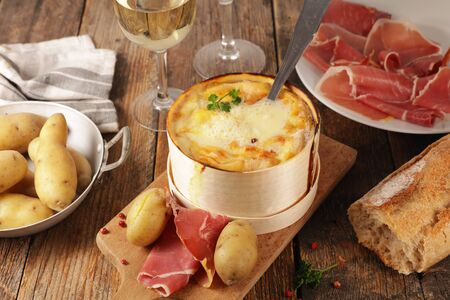 mont dor, traditional french dish- cheese fondue with bacon, salami and potato