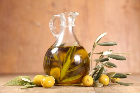bottle of olive oil and herbs