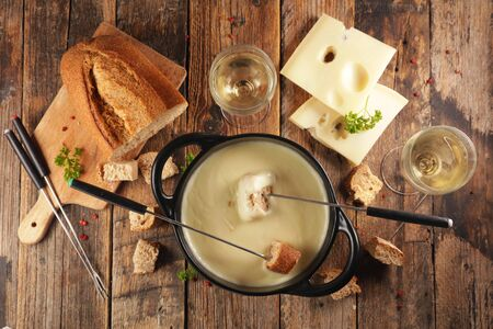 cheese fondue with wine and bread, top view Stock Photo