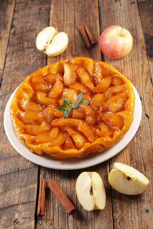 tarte tatin, french apple pie on wood background
