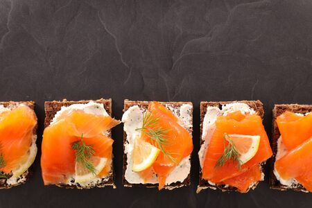 festive canape with cream and salmon, top view