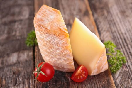 cheese portion on wood background 스톡 콘텐츠
